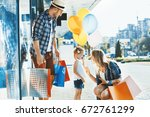 happy family with shopping bags ... | Shutterstock . vector #672761299