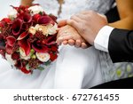 hands of the newlyweds with a... | Shutterstock . vector #672761455