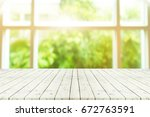perspective wooden table on top ... | Shutterstock . vector #672763591