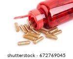 pills and pill bottle on white... | Shutterstock . vector #672769045