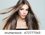 beautiful girl with blowing... | Shutterstock . vector #672777565