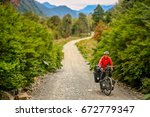 cyclist climbing up the hill on ... | Shutterstock . vector #672779347
