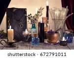 mystic objects  black candles ... | Shutterstock . vector #672791011