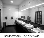 clean modern toilet at a... | Shutterstock . vector #672797635