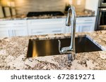 new modern faucet and kitchen... | Shutterstock . vector #672819271