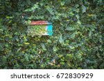 old box post and green leafs | Shutterstock . vector #672830929
