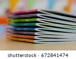 edge book on the wooden table.  ... | Shutterstock . vector #672841474