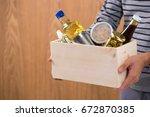 volunteer with donation box... | Shutterstock . vector #672870385