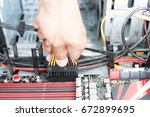 men hand hold connect power... | Shutterstock . vector #672899695