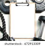 mockup clipboard with gym... | Shutterstock . vector #672913309