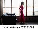 beautiful girl in an amazing... | Shutterstock . vector #672923389