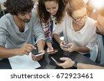 young people having fun using... | Shutterstock . vector #672923461