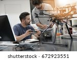 engineer and technician working ... | Shutterstock . vector #672923551