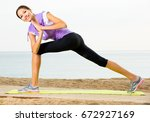 happy girl practising yoga... | Shutterstock . vector #672927169
