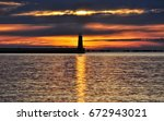 beautiful gold sunrise over the ... | Shutterstock . vector #672943021