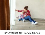 young mother holding her young... | Shutterstock . vector #672958711