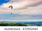 skydiving flying in the clouds... | Shutterstock . vector #672962464
