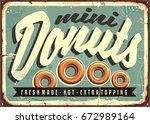 mini donuts  fresh and hot ... | Shutterstock .eps vector #672989164