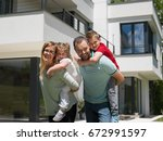 portrait of young happy family... | Shutterstock . vector #672991597
