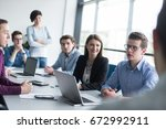 group of business people... | Shutterstock . vector #672992911