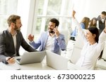 group of happy business people... | Shutterstock . vector #673000225