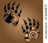 isolated vector bear paw with... | Shutterstock .eps vector #673000879