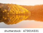 Stock photo beautiful lake and autumn forest in the mountains 673014331