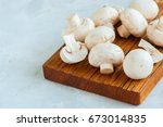 whole and slices of mushrooms... | Shutterstock . vector #673014835