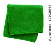 green towel isolated on white... | Shutterstock . vector #673028989