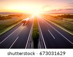 highway in a strong back light... | Shutterstock . vector #673031629