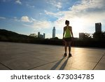 young fitness woman jumping...   Shutterstock . vector #673034785