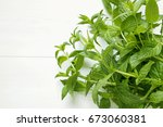 bunch of fresh green mint on... | Shutterstock . vector #673060381