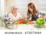 grandmother and granddaughter... | Shutterstock . vector #673073464