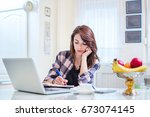 young female student writing in ... | Shutterstock . vector #673074145