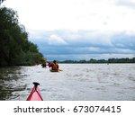nose of red kayak in danube... | Shutterstock . vector #673074415
