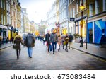 shoppers walk down busy central ... | Shutterstock . vector #673083484
