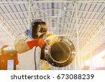 worker welder pipe welding and... | Shutterstock . vector #673088239
