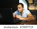 armenian handsome man working... | Shutterstock . vector #673097719