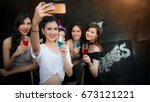 group of friends taking selfie... | Shutterstock . vector #673121221