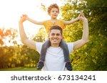 smiling man in white t shirt... | Shutterstock . vector #673134241