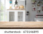 wood desk space and blurred of... | Shutterstock . vector #673146895