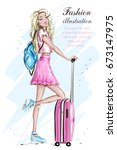 fashion girl with suitcase.... | Shutterstock .eps vector #673147975