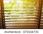 wooden blinds with sun light. | Shutterstock . vector #673166731