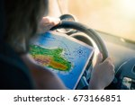 a young woman is driving a car... | Shutterstock . vector #673166851