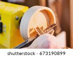 turning a wooden plate on a... | Shutterstock . vector #673190899