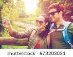travel  hiking  backpacking ... | Shutterstock . vector #673203031