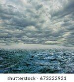storm in the ocean breaking the ... | Shutterstock . vector #673222921