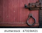 forged handle on the door. old...   Shutterstock . vector #673236421