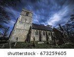 moonlit church and graveyard at ...