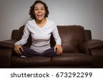 woman watching a sports game at ... | Shutterstock . vector #673292299